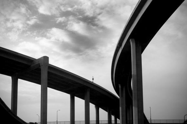 Two overpasses merging together into one representing coming together via mediation.