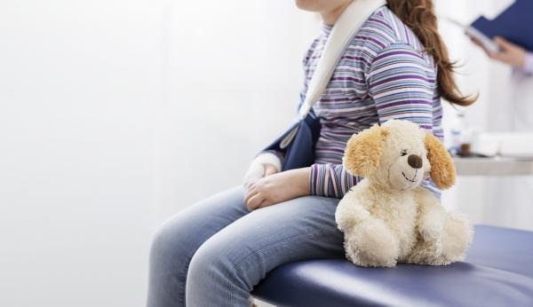 Girl with fracture and stuffy