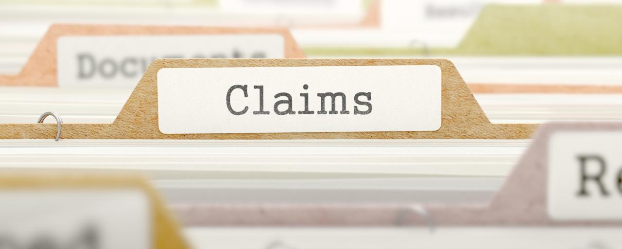 Filing cabinet with 'claims' tab highlighted