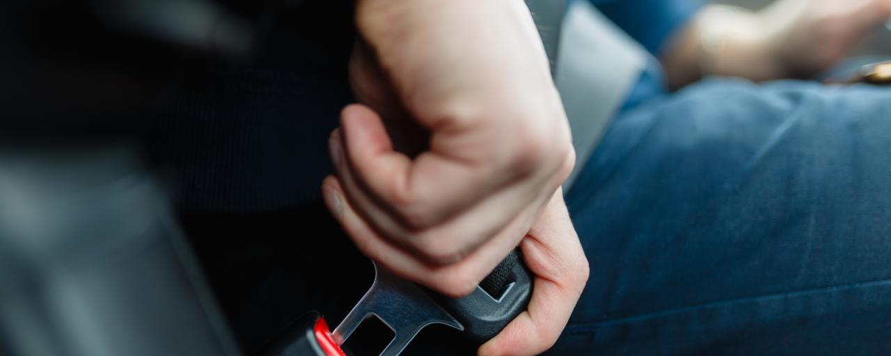 Man putting on a seatbelt